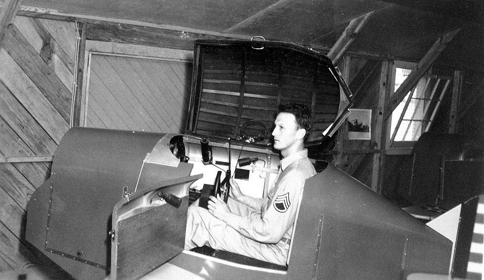 LinkTrainerSeymourIndiana. TSgt James R. Schneid is shown at the controls of this early flight simulator