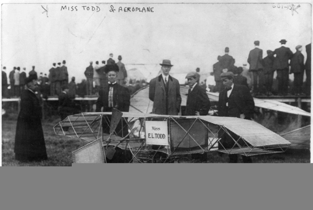 E. Lillian Todd standing with her airplane.3b21391u