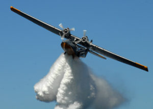 090925-N-9860Y-006 OAK HARBOR, Wash. (Sept. 25, 2009) A PBY-6A Catalina drops a load of water from its bomb-bay doors over Crescent Harbor. The aircraftÕs departure marked the end of a weeklong visit to Naval Air Station Whidbey Island and Oak Harbor. The visit coincided with the 67th anniversary of NAS Whidbey Island on Sept. 21 and the 11th anniversary of the PBY Memorial Foundation, located on the Seaplane Base, Sept. 22. (U.S. Navy photo by Mass Communication Specialist 2nd Class Tucker M. Yates/Released)